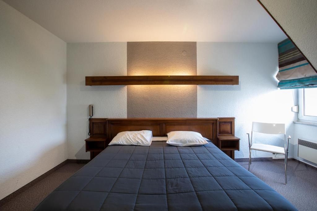 Un ou plusieurs lits dans un hébergement de l'établissement Hôtel Restaurant et Spa Au Tilleul
