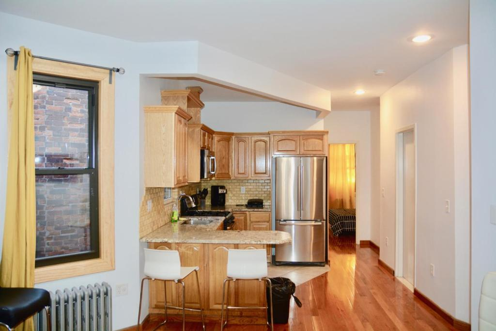 A kitchen or kitchenette at The Topping Three-Bedroom Apartment