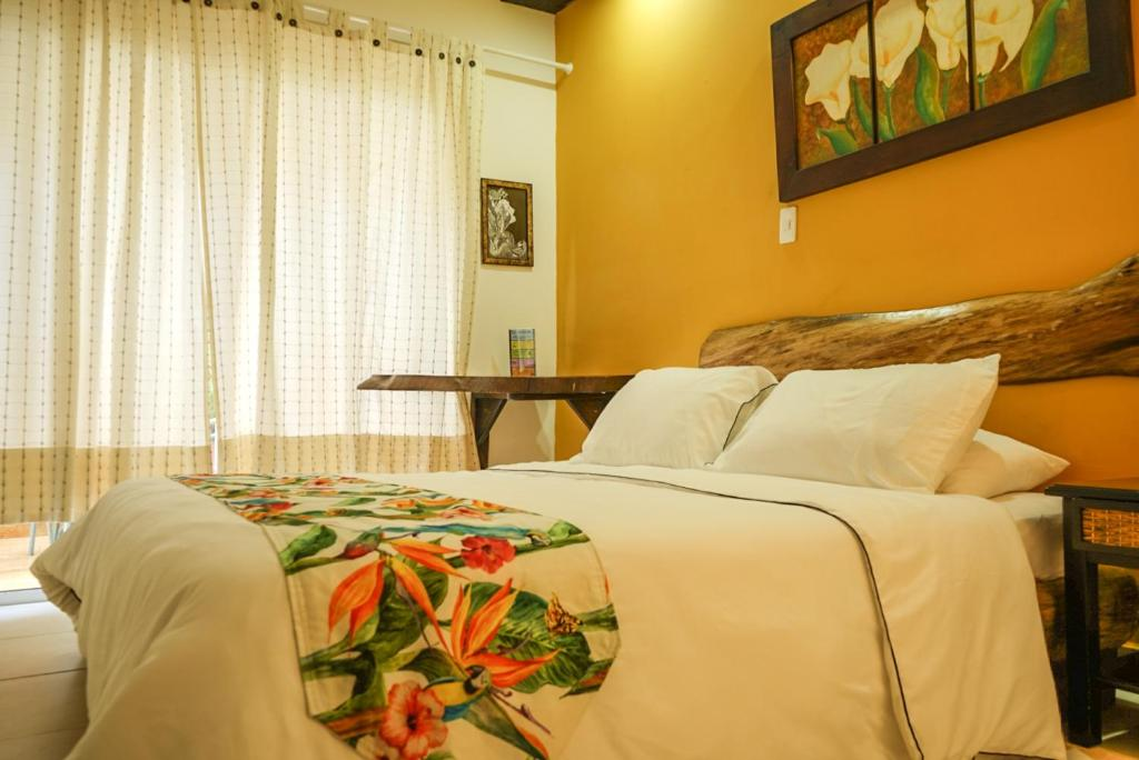 A bed or beds in a room at Kolibri Hostel