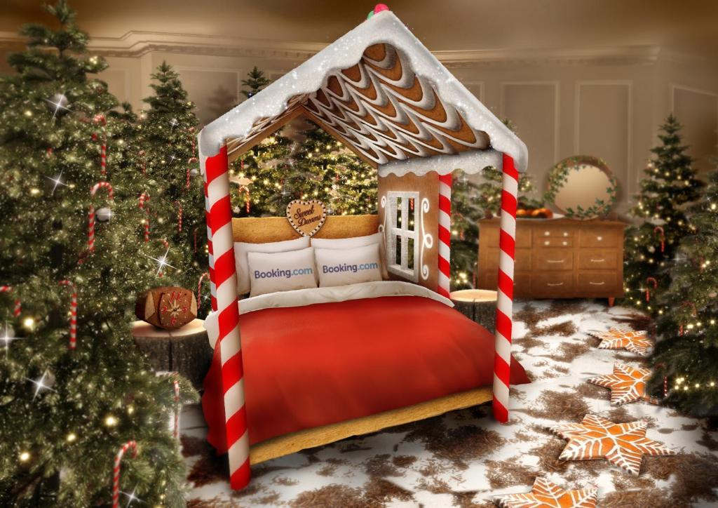 A bed or beds in a room at BOOKING.COM CANDY CANE HOUSE