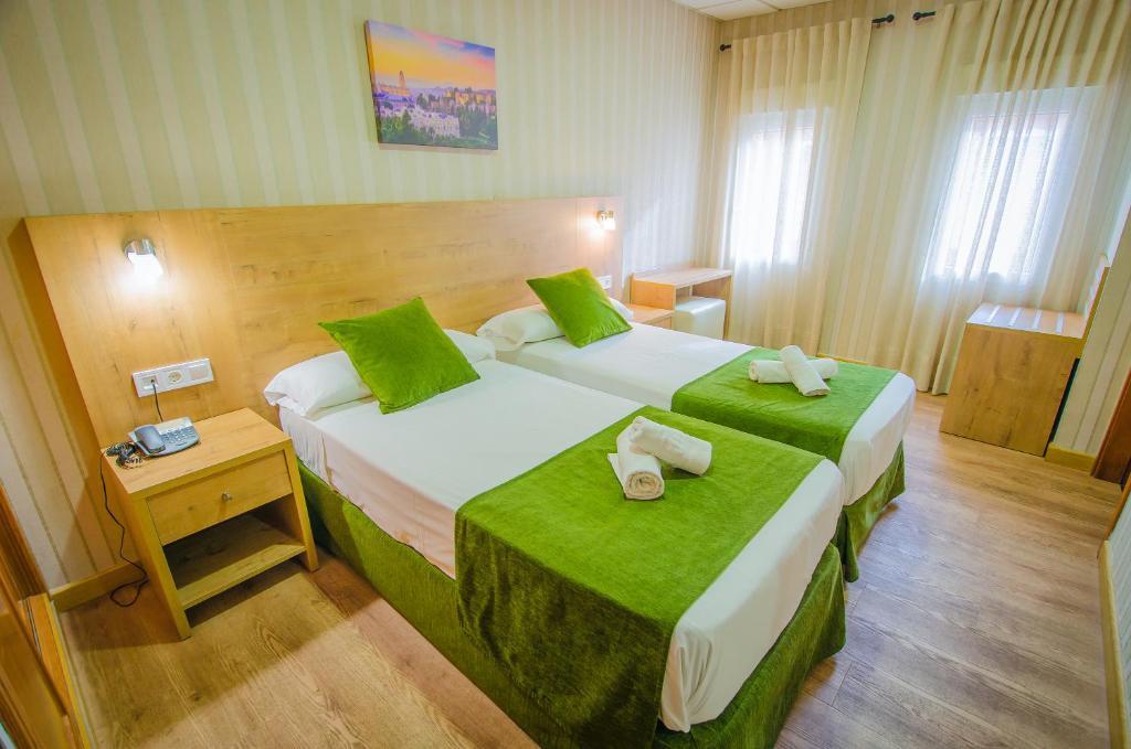 Cama o camas de una habitación en Hotel Solymar