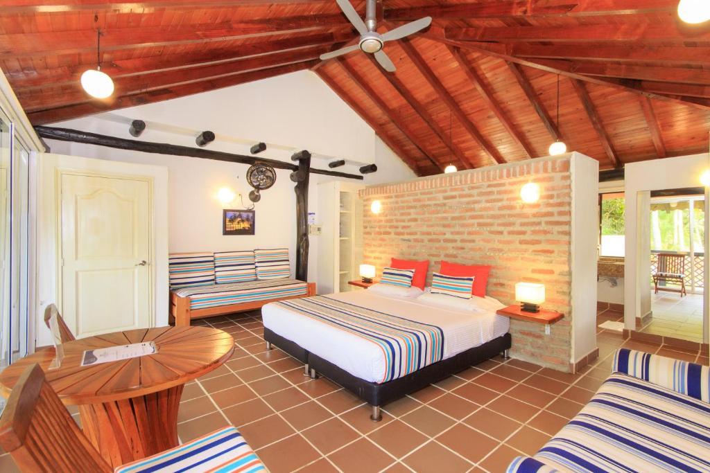 A bed or beds in a room at La Mar de Bien