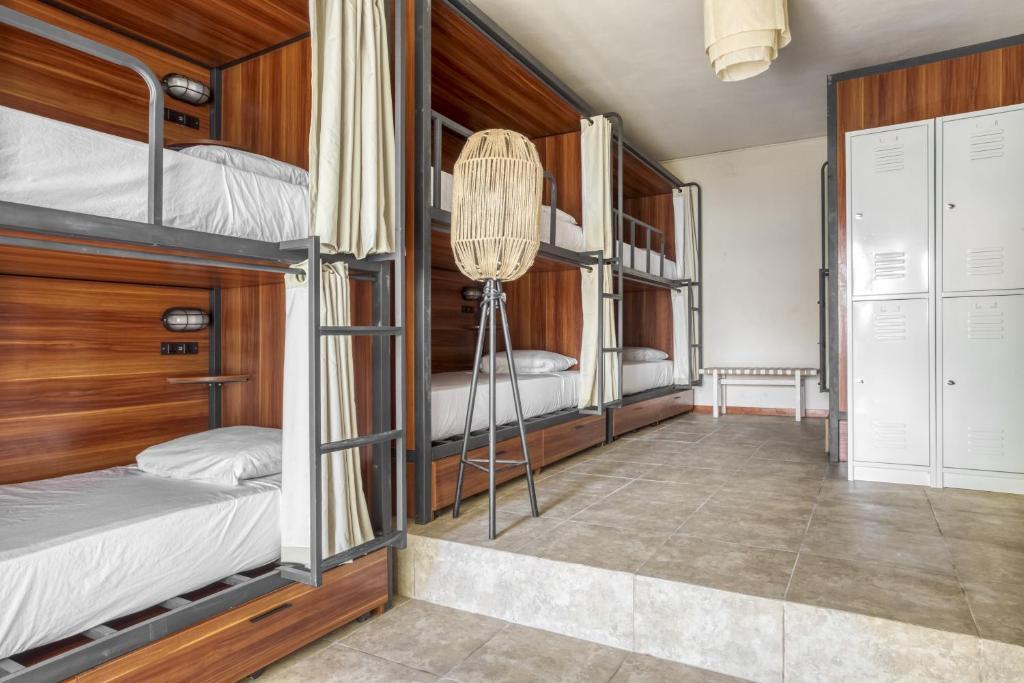 A bunk bed or bunk beds in a room at Selina Shared Los Lirios Tulum
