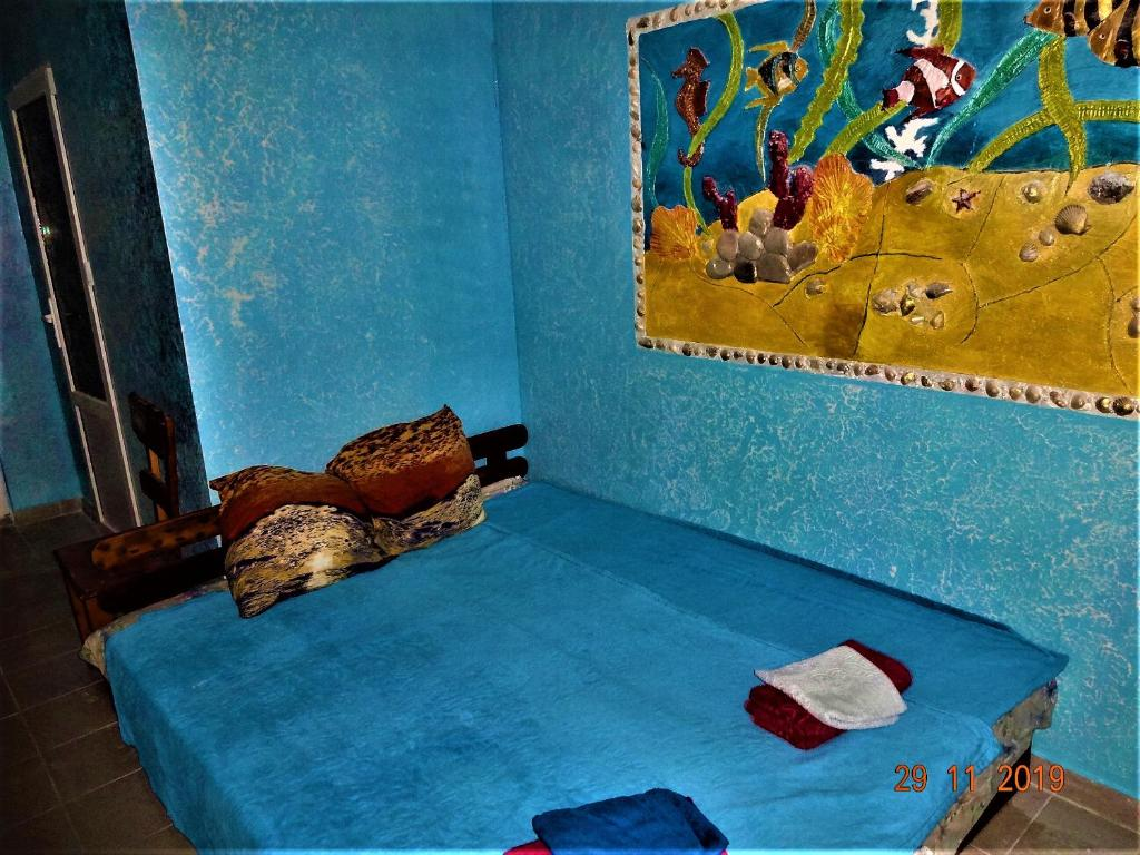 A bed or beds in a room at Guest House Azovsafari