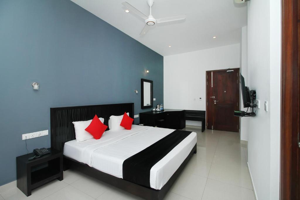 Ein Bett oder Betten in einem Zimmer der Unterkunft Golden Pier City Hotel