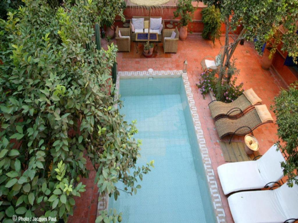 A view of the pool at Riad Les Cigognes or nearby