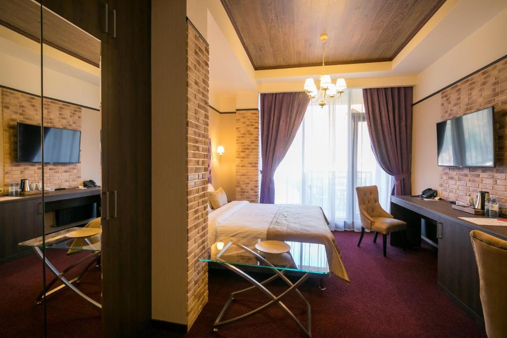 Кровать или кровати в номере VERTEX hotel