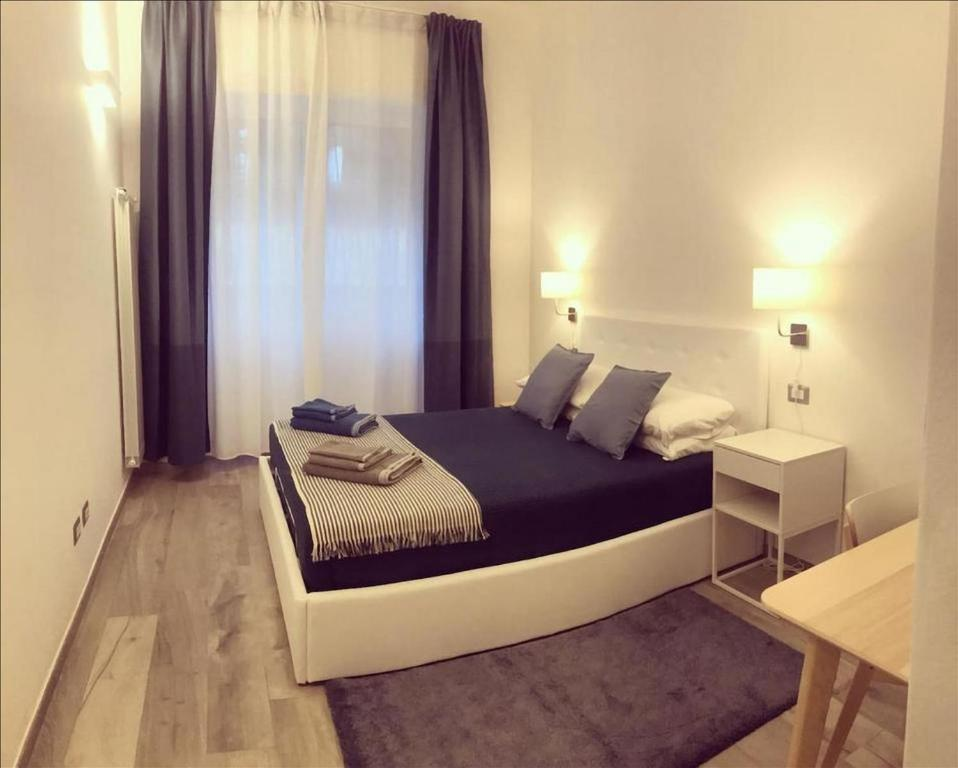 A bed or beds in a room at Brand new stylish apartment in Navigli Area
