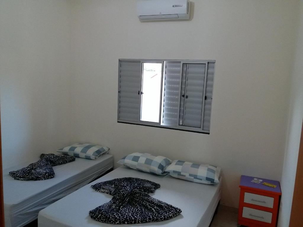 A bed or beds in a room at Atlantico Residencial