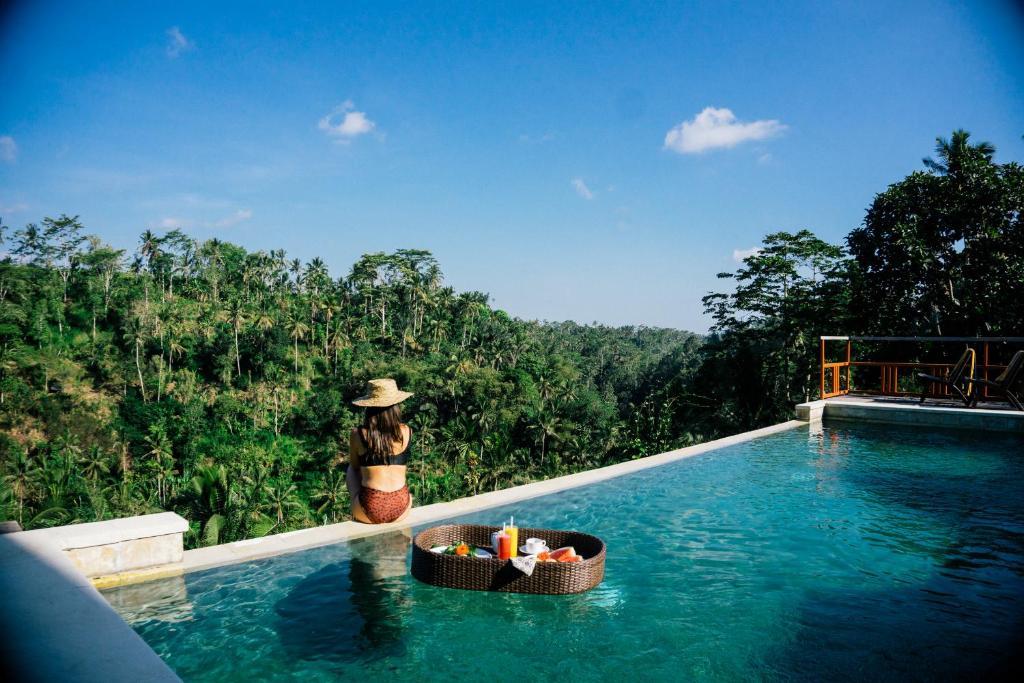 The swimming pool at or near Suarapura Resort & Spa
