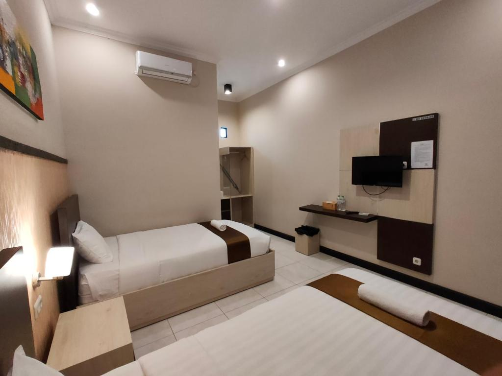 A bed or beds in a room at Hotel Orizatha