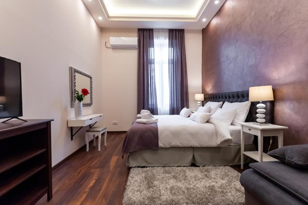 A bed or beds in a room at Mala Sava Apartmani