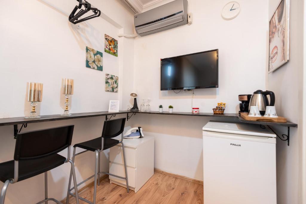 Телевизор и/или развлекательный центр в 3 Floor Oldcity