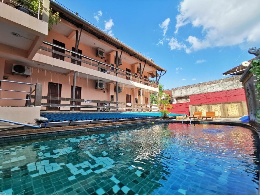 The swimming pool at or near Baan Veerakit Hotel