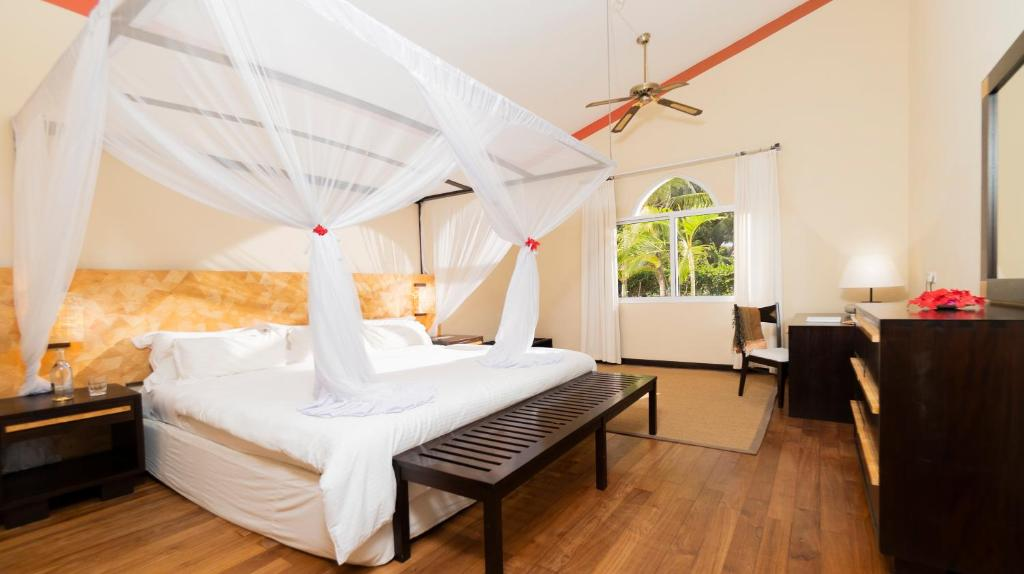 A bed or beds in a room at Diamonds Dream of Africa
