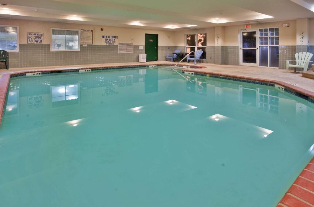 The swimming pool at or near Country Inn & Suites by Radisson, Beaufort West, SC