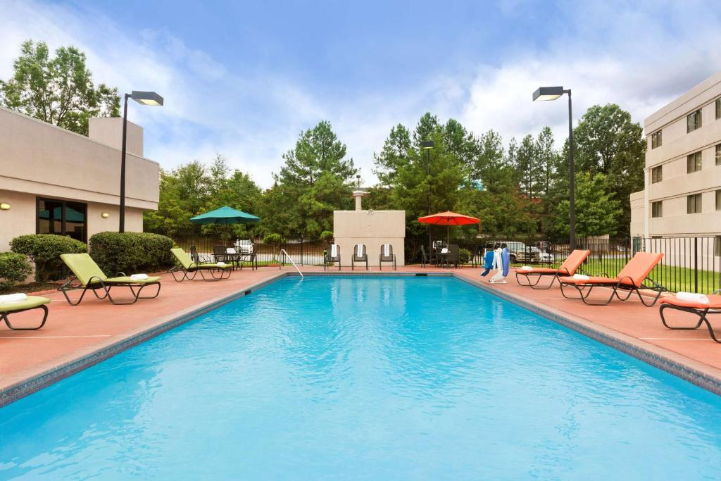 The swimming pool at or near Country Inn & Suites by Radisson, Atlanta Airport South, GA