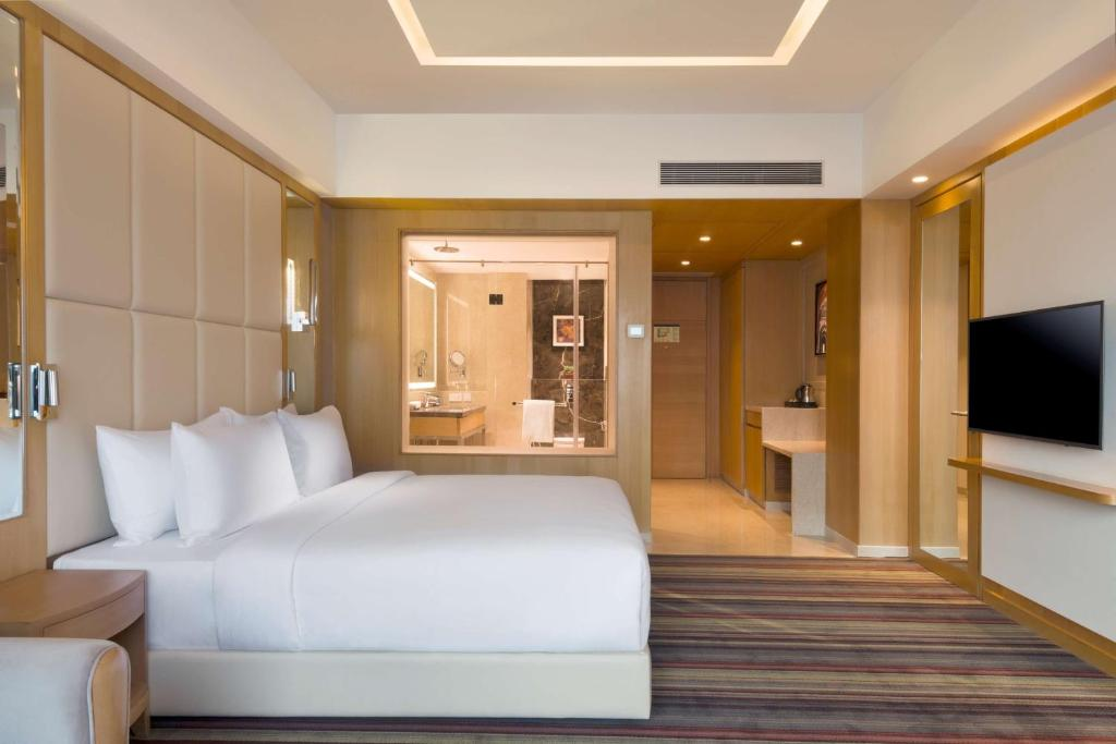A bed or beds in a room at Radisson Blu Gorakhpur
