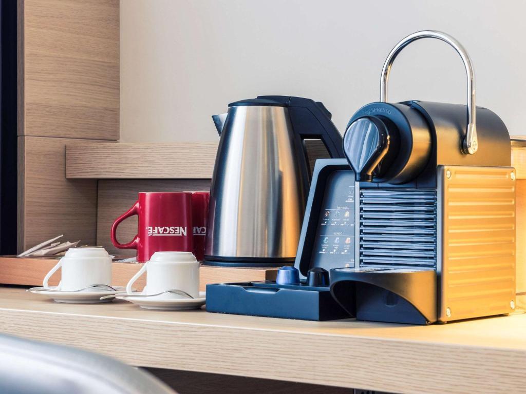 Принадлежности для чая и кофе в Отель MERCURE Роза Хутор