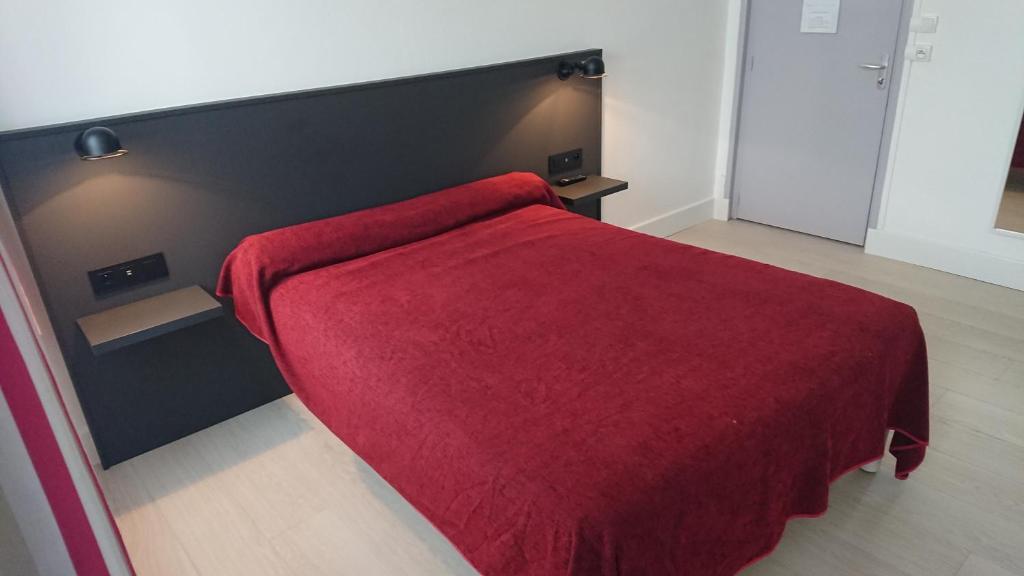 Un ou plusieurs lits dans un hébergement de l'établissement Hôtel Faidherbe