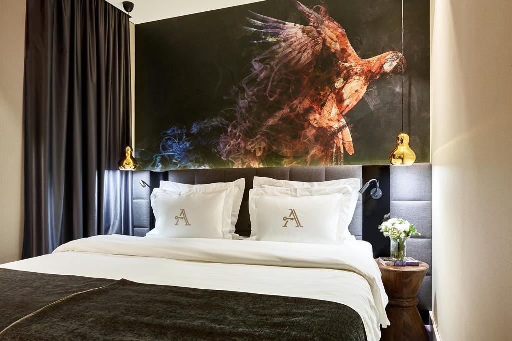 Кровать или кровати в номере Отель Акварель