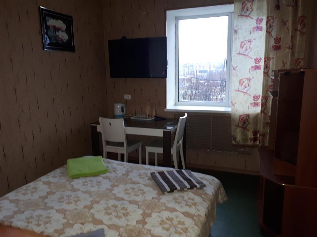 Кровать или кровати в номере Mini-Hotel Berkut