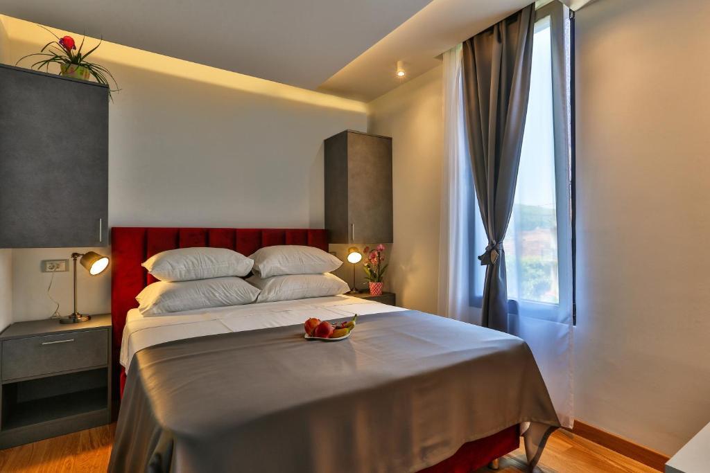 Krevet ili kreveti u jedinici u okviru objekta Hotel M