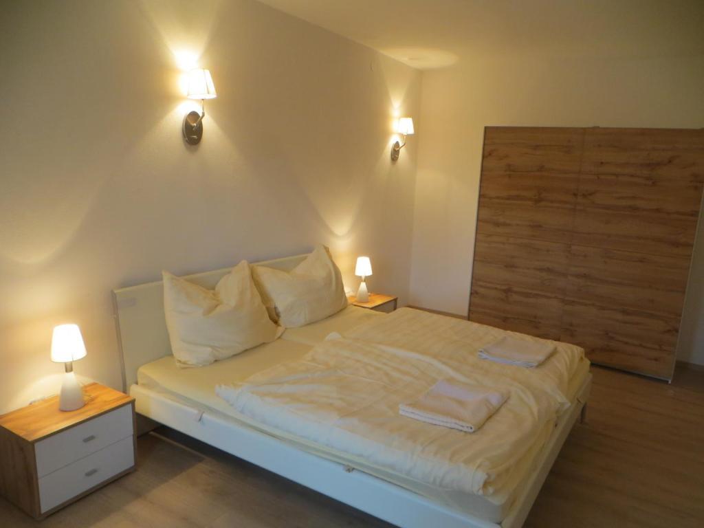 Ein Bett oder Betten in einem Zimmer der Unterkunft City Apartment Amadeus