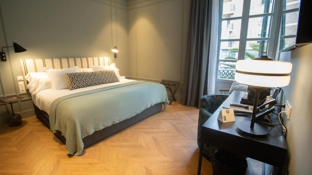 A bed or beds in a room at Soho Boutique Colón