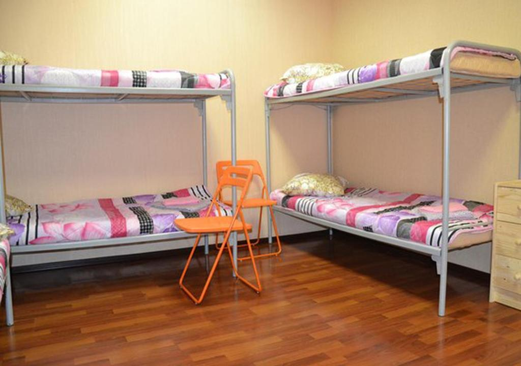A bunk bed or bunk beds in a room at Hostel UFO