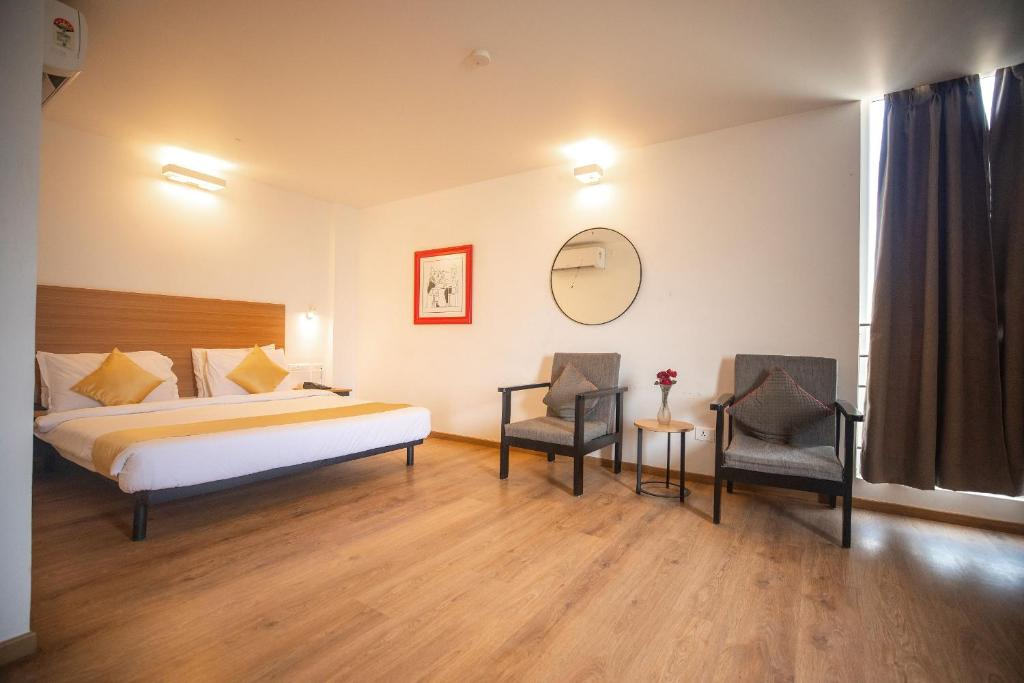 A bed or beds in a room at Transit Manyata by Staytrendz