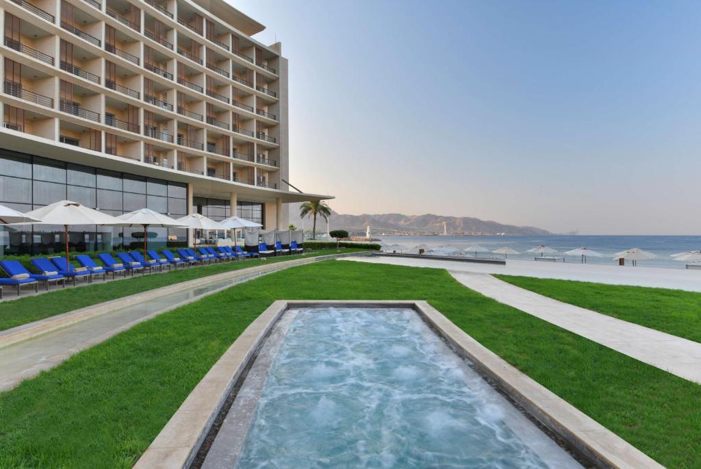 The swimming pool at or near Kempinski Hotel Aqaba