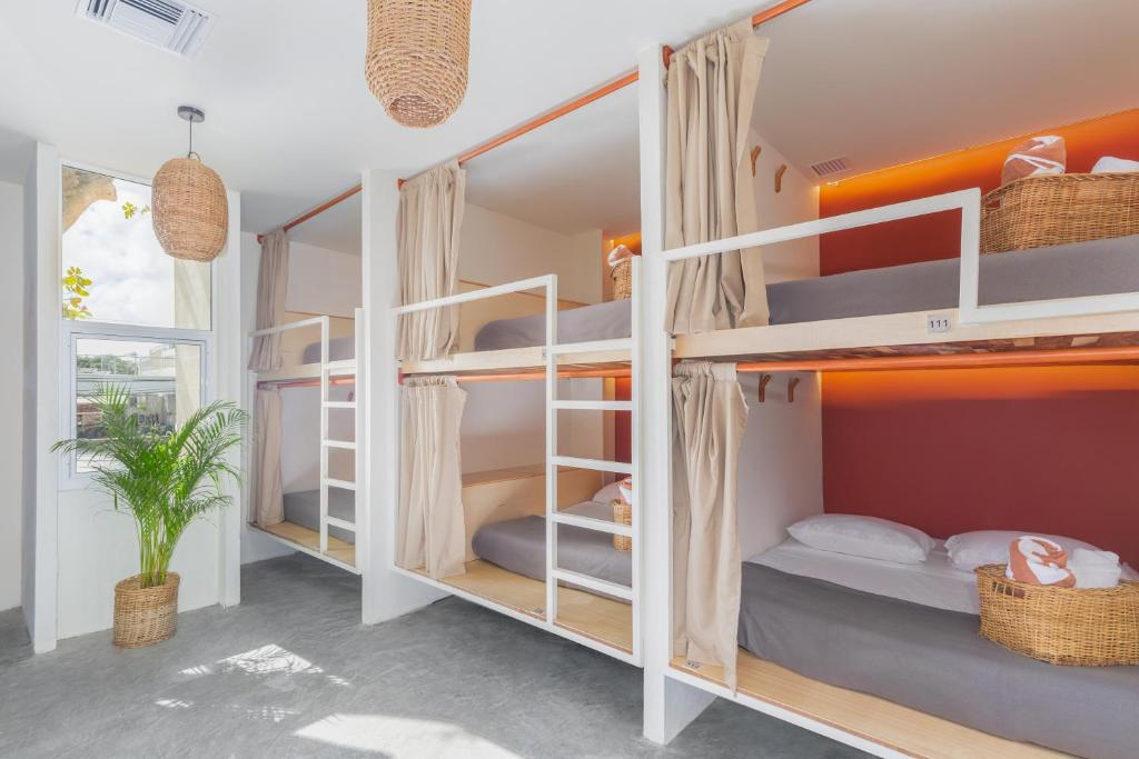 A bunk bed or bunk beds in a room at Oostel Smart Hostel
