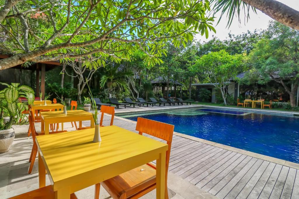 The swimming pool at or near Capital O 2114 Grand Jimbaran