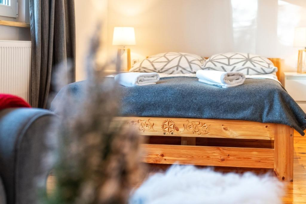 Postel nebo postele na pokoji v ubytování Gabi Apartament Zakopane