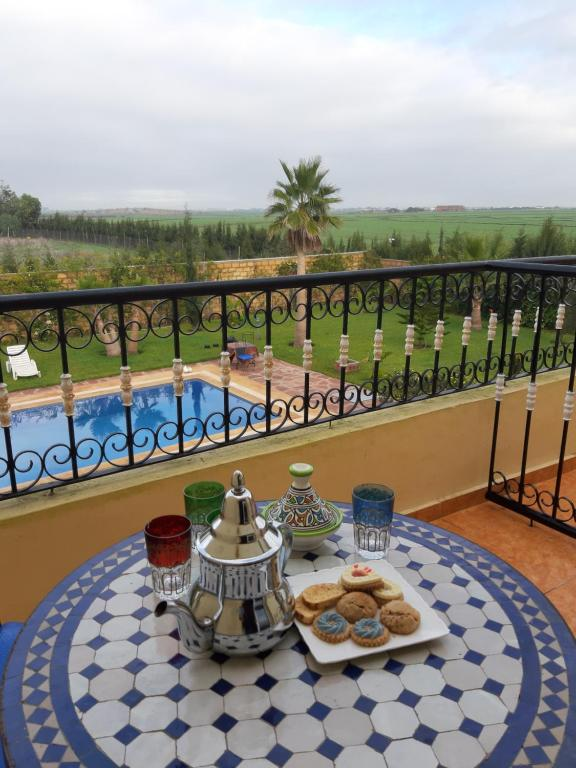 A view of the pool at Riad TANJIL or nearby