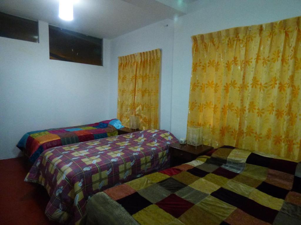 Cama o camas de una habitación en La Casona de Luisa