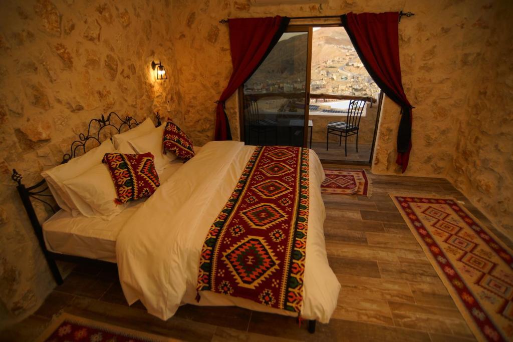 Cama o camas de una habitación en Infinity Lodge