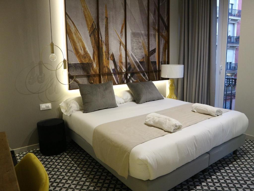 Cama o camas de una habitación en YOU & CO. Quart Boutique