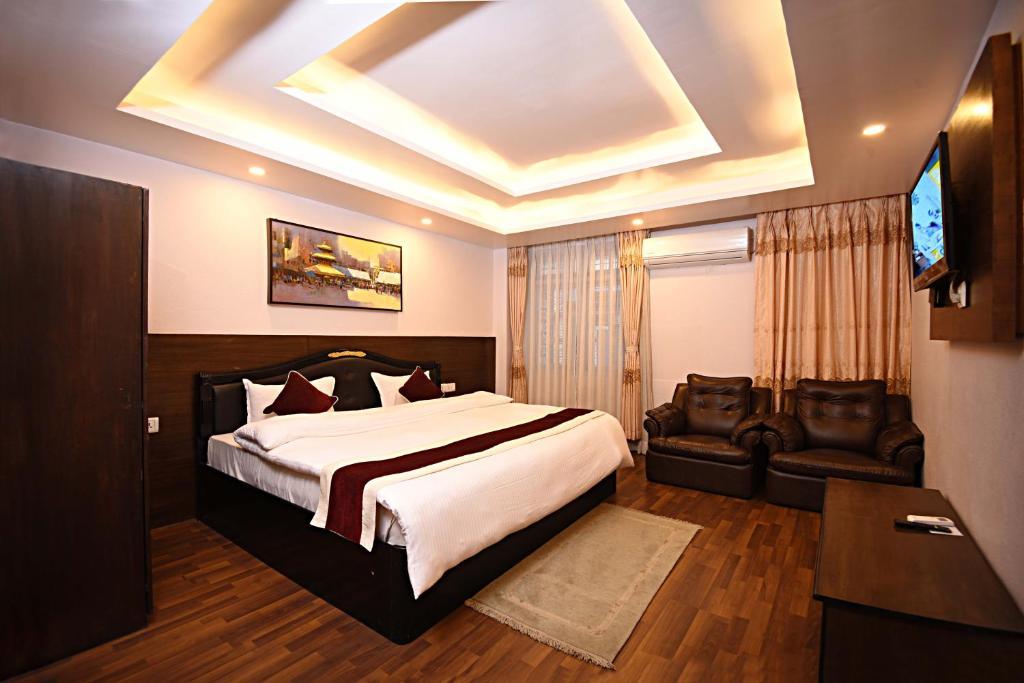 Ein Bett oder Betten in einem Zimmer der Unterkunft Greatwall International Hotel