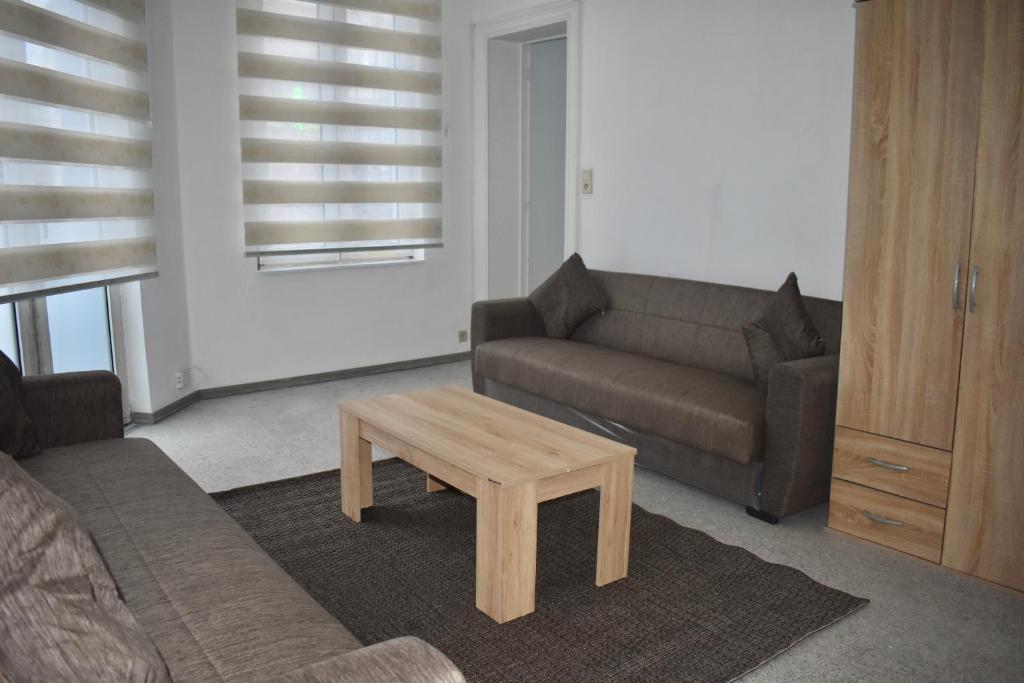 A seating area at appartement central 2: close to gare du midi