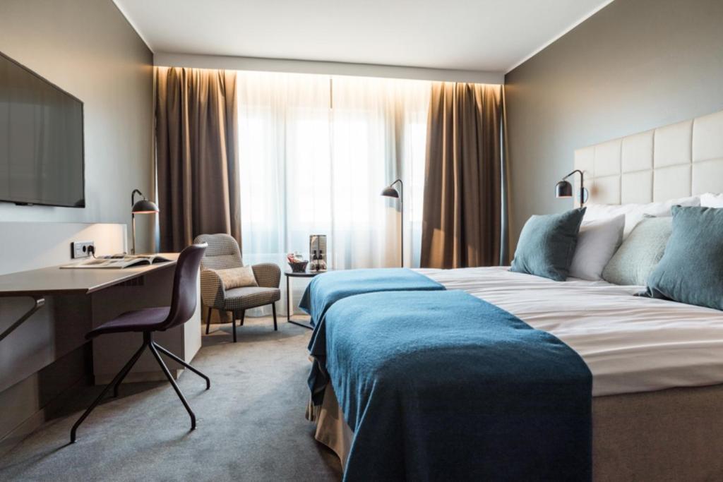 Säng eller sängar i ett rum på Clarion Hotel Gillet