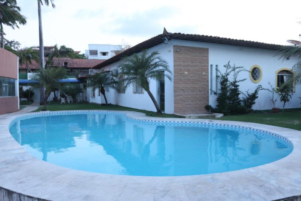 The swimming pool at or near Pousada Pôr do Sol