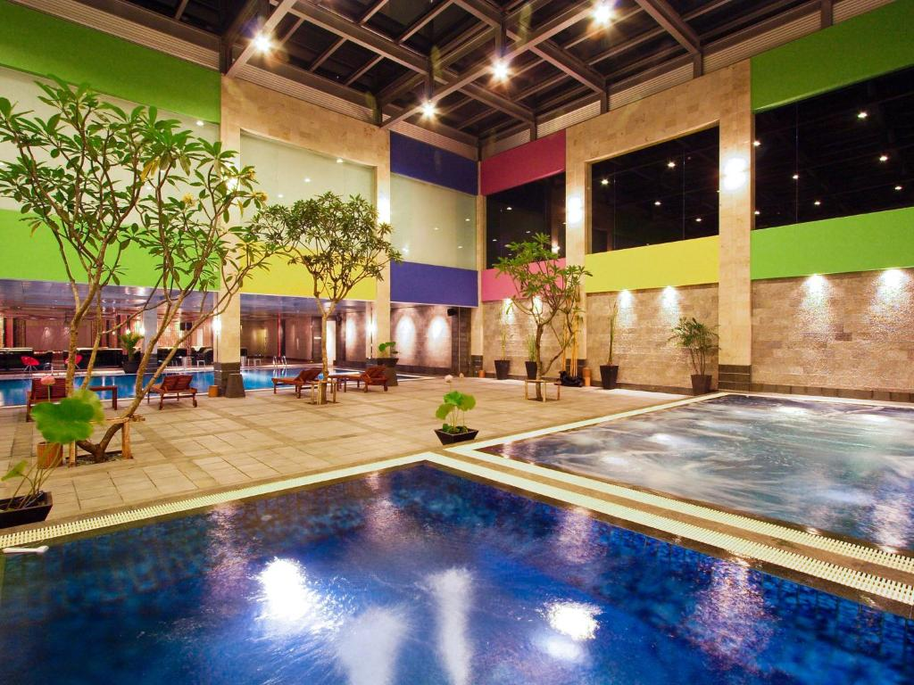 The swimming pool at or near FM7 Resort Hotel - Jakarta Airport