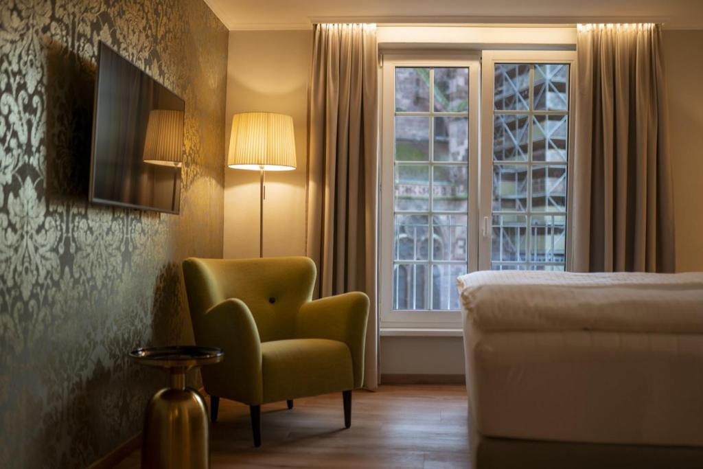 Un lugar para sentarse en Hotel Rappen am Münsterplatz