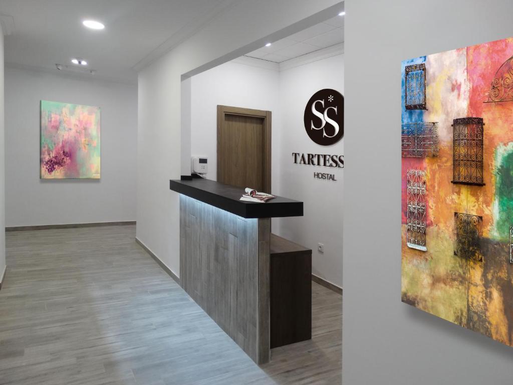 The lobby or reception area at Hostal Tartessos