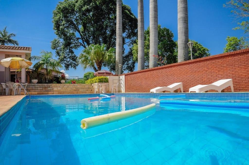 The swimming pool at or near Pousada Nova Estância