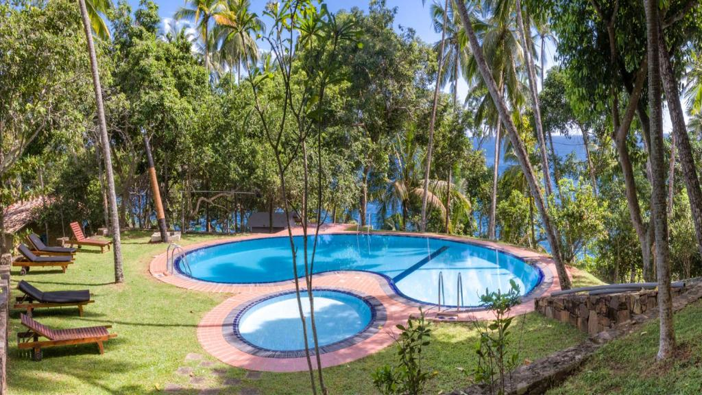 A view of the pool at Palace Mirissa or nearby