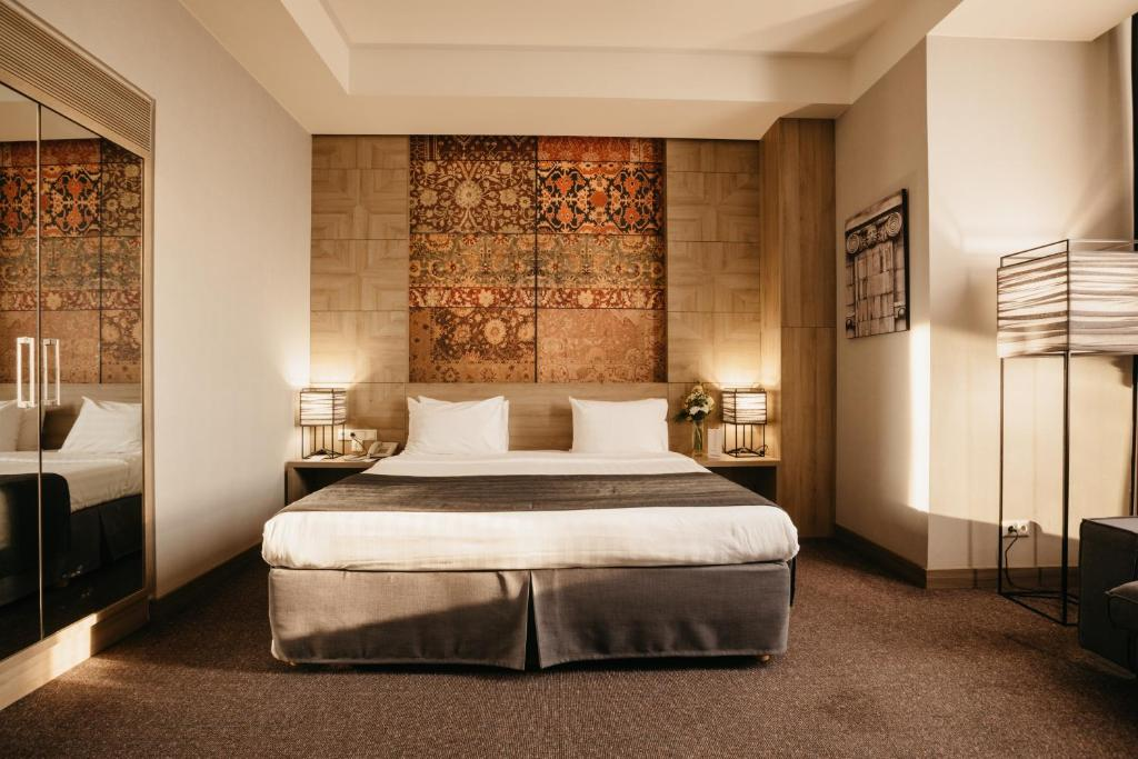 A bed or beds in a room at Republica Hotel Yerevan