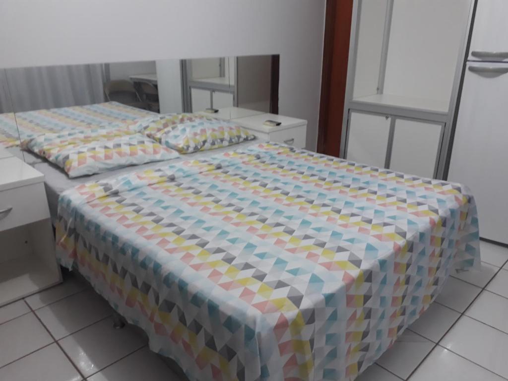 Кровать или кровати в номере Apart Acquaville Caldas Novas